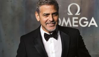 "FILE - In this April 26, 2017 file photo, actor-director George Clooney arrives at the 60th anniversary of the Omega Speedster watch in London. Clooney directs the upcoming film, ""Suburbicon,"" written by starring Matt Damon, Oscar Isaac and Julianne Moore. (Photo by Grant Pollard/Invision/AP, File)"