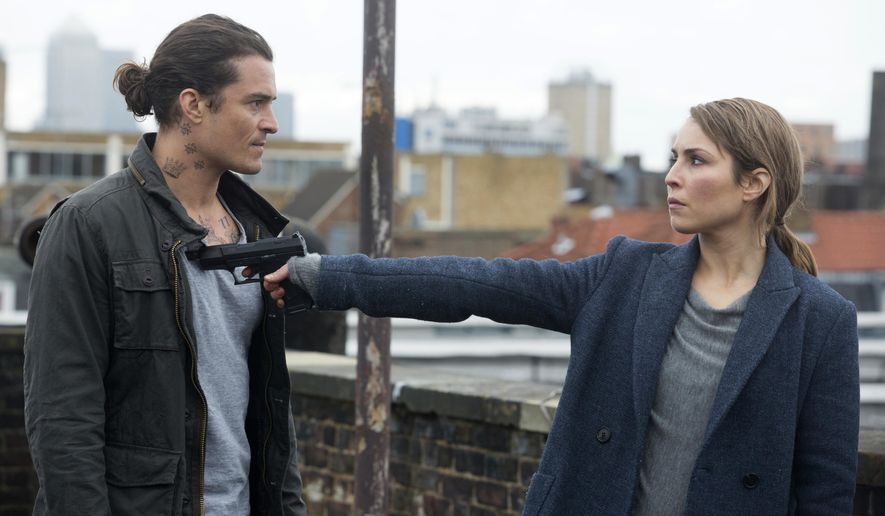 """This image released by Lionsgate shows Orlando Bloom, left, and Noomi Rapace in a scene from """"Unlocked."""" (Larry Horricks/Lionsgate via AP)"""