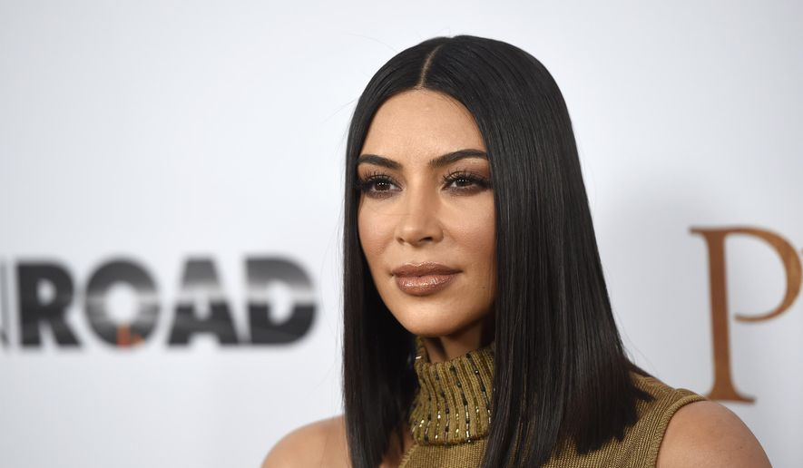 """In this April 12, 2017, file photo, Kim Kardashian West arrives at the U.S. premiere of """"The Promise"""" in Los Angeles. Kardashian West and her famous siblings are donating $500,000 to help victims of Hurricane Harvey. A spokeswoman for the reality star says she and her mother and sisters have given $250,000 to the Red Cross and $250,000 to the Salvation Army on Tuesday, Aug. 29. (Photo by Chris Pizzello/Invision/AP, File)"""