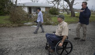 Texas Gov. Greg Abbott surveys damage during a tour of areas affected by Hurricane Harvey, on Monday, Aug. 28, 2017. Harvey hit the coast as a Category 4 hurricane. (Courtney Sacco/Corpus Christi Caller-Times via AP)