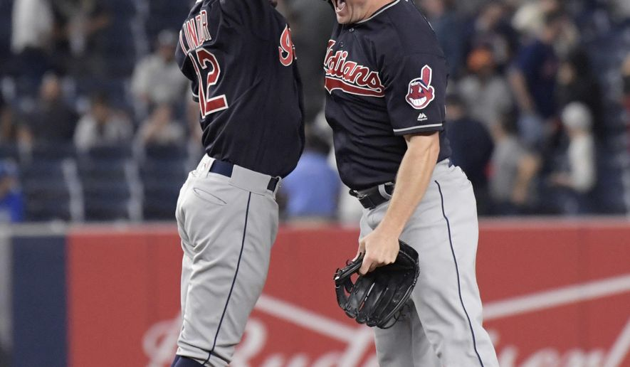Cleveland Indians shortstop Francisco Lindor, left, and right fielder Jay Bruce celebrate after the Indians defeated the New York Yankees 6-2 in a baseball game, Monday, Aug. 28, 2017, at Yankee Stadium in New York. (AP Photo/Bill Kostroun)