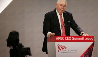 In this Friday, Nov. 13, 2017, photo, Chief Executive Officer for Freeport-McMoRan Copper and Gold Richard Adkerson addresses the APEC CEO Summit in Singapore. Indonesia is allowing Freeport-McMoRan to continue operating a giant gold and copper mine after the U.S. company agreed Tuesday to relinquish majority ownership of it to the government. (AP Photo/Gemunu Amarasinghe, File)