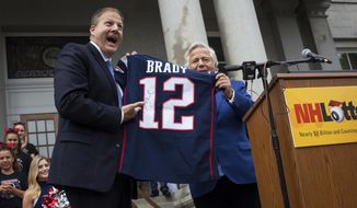 Gov. Chris Sununu is gifted a jersey signed by Tom Brady from New England Patriots Chairman at the State House for a launch of a Patriots scratch ticket game in Concord on Tuesday, Aug. 29, 2017. The game, which is available only in New Hampshire in 1,200 stores starting Tuesday, features four, $100,000 grand prizes and the chance to enter a series of second-chance drawings to win Patriot tickets. (Elizabeth Frantz/Concord Monitor via AP)