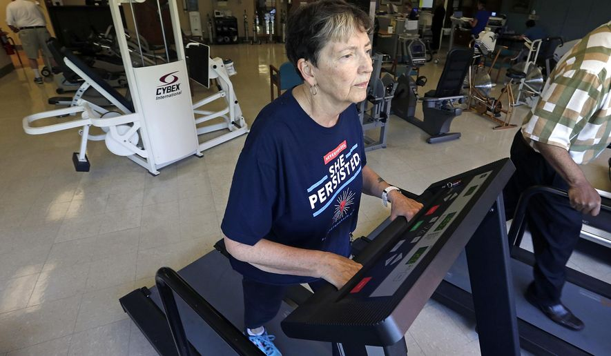 In this Aug. 15, 2017, photo, Rita Driscoll works on a treadmill in a supervised exercise therapy program for patients with peripheral artery disease at University of Minnesota Medical Center in Minneapolis. Medicare soon will start paying hospitals and clinics for these exercise sessions, making the therapy available for thousands of older Americans with a specific type of leg pain. (AP Photo/Jim Mone)