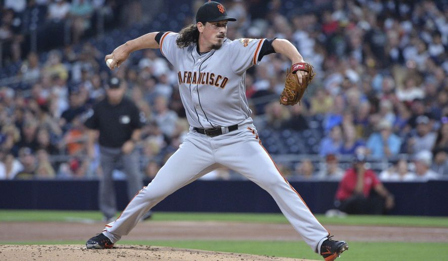 San Francisco Giants starting pitcher Jeff Samardzija delivers a pitch to a San Diego Padres batter during the first inning of a baseball game, Monday, Aug. 28, 2017, in San Diego. (AP Photo/Orlando Ramirez)