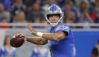 FILE - This Aug. 25, 2017 file photo shows Detroit Lions quarterback Matthew Stafford looking downfield during the first half of the team's NFL preseason football game against the New England Patriots in Detroit. Aaron Rodgers and the Green Bay Packers have regained their hold on the NFC North after a one-year lapse. The Minnesota Vikings, Detroit Lions and Chicago Bears will have to go through Lambeau Field once again if they're going to take the division.  (AP Photo/Rick Osentoski, File)