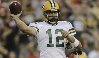 FILE - In this Saturday, Aug. 19, 2017 file photo, Green Bay Packers quarterback Aaron Rodgers (12) passes the ball during the first half of an NFL preseason football game against the Washington Redskins in Landover, Md. Aaron Rodgers and the Green Bay Packers have regained their hold on the NFC North after a one-year lapse. The Minnesota Vikings, Detroit Lions and Chicago Bears will have to go through Lambeau Field once again if they're going to take the division. (AP Photo/Mark Tenally, File)