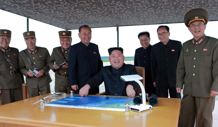 This Aug. 29, 2017 photo distributed on Wednesday, Aug. 30, 2017, by the North Korean government, North Korean leader Kim Jong Un, center,  smiles as Kim inspects the test launch of a Hwasong-12 intermediate range missile in Pyongyang, North Korea. Leader Kim called for more ballistic missile tests targeting the Pacific Ocean, Pyongyang announced Wednesday, a day after his nation for the first time flew a ballistic missile designed to carry a nuclear payload over Japan. Independent journalists were not given access to cover the event depicted in this image distributed by the North Korean government. The content of this image is as provided and cannot be independently verified. (Korean Central News Agency/Korea News Service via AP)