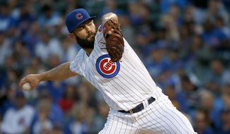 Chicago Cubs starting pitcher Jake Arrieta works against the Pittsburgh Pirates during the first inning of a baseball game Tuesday, Aug. 29, 2017, in Chicago. (AP Photo/Charles Rex Arbogast)