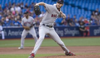 Boston Red Sox starting pitcher Chris Sale works against the Toronto Blue Jays during the first inning of a baseball game Tuesday, Aug. 29, 2017, in Toronto. (Chris Young/The Canadian Press via AP)