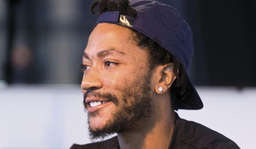 In this Friday, Aug. 25, 2017, photo, Cleveland Cavaliers point guard Derrick Rose poses for a photo at his agent's Wasserman Media Group offices in Los Angeles. Rose, 28, the former MVP is coming off a fourth knee surgery, though now will be pairing with LeBron James and joining a team that has made three consecutive trips to the NBA Finals. (AP Photo/Damian Dovarganes)