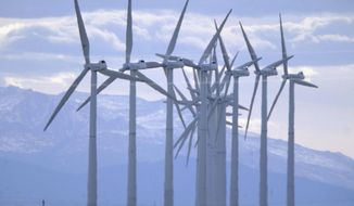 FILE - In this Oct. 10, 2002, file photo, turbines blow in the wind at an Xcel Energy wind farm located on the border of Colorado and Wyoming south of Cheyenne, Wyo. Xcel announced Tuesday, Aug. 29, 2017, it is considering closing down two coal-fired generating units in Pueblo, Colorado, and replacing their output with power from a mix of wind, solar and natural gas. (AP Photo/David Zalubowski, File)