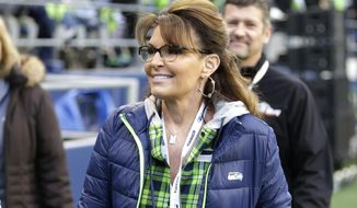 FILE- In this Dec. 15, 2016, file photo, Sarah Palin, political commentator and former Governor of Alaska, walks on the sideline before an NFL football game between the Seattle Seahawks and the Los Angeles Rams in Seattle. A federal judge on Tuesday, Aug. 29, 2017, tossed out a defamation lawsuit by Palin against The New York Times, saying the former Alaska governor failed to show the newspaper knew it was publishing false statements in an editorial before quickly correcting them. (AP Photo/Scott Eklund, File)
