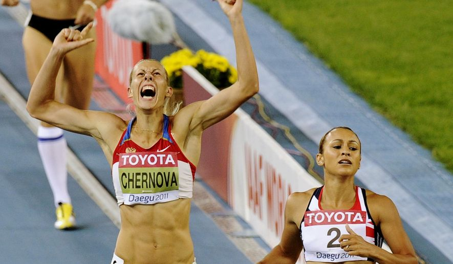 FILE - In this Aug. 30 2011 file photo, Russia's Tatyana Chernova, left, reacts as she goes to cross the finish line with Britain's Jessica Ennis in the Heptathlon 800m at the World Athletics Championships in Daegu, South Korea. Because of a doping violation, Chernova was subsequently stripped of her gold from the 2011 world championships in Daegu. (AP Photo/Martin Meissner, File)