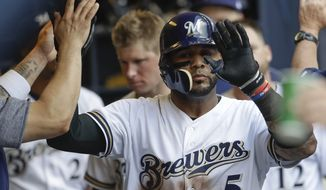 Milwaukee Brewers' Jonathan Villar celebrates his two-run home run during the sixth inning of a baseball game against the St. Louis Cardinals Wednesday, Aug. 30, 2017, in Milwaukee. (AP Photo/Morry Gash)