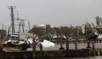 In this Aug. 26, 2017, photo, shrimp and oyster boats are strewn about in the Seadrift, Texas, docks after Hurricane Harvey hit the area. (Nicolas Galindo/The Victoria Advocate via AP) ** FILE **
