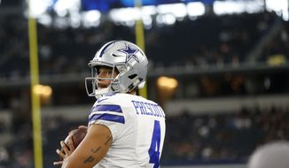 Dallas Cowboys quarterback Dak Prescott (4) throws a pass during warm ups before a preseason NFL football game against the Oakland Raiders on Saturday, Aug. 26, 2017, in Arlington, Texas. (AP Photo/Ron Jenkins)