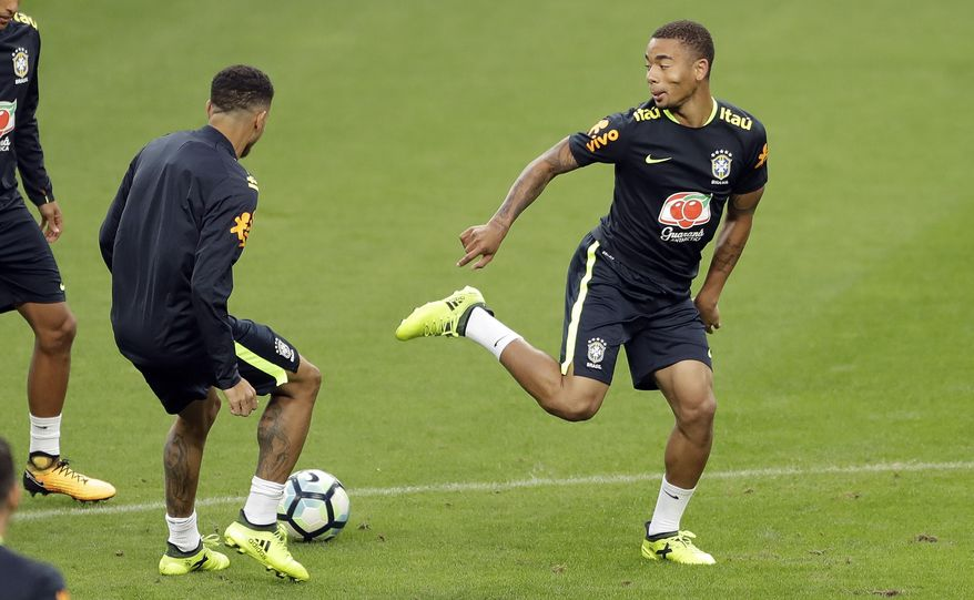 Brazil's Gabriel Jesus, right, and Taison train in Porto Alegre, Brazil, Wednesday, Aug. 30, 2017. Brazil will face Ecuador in a 2018 World Cup qualifying soccer match on Aug. 31. (AP Photo/Andre Penner)