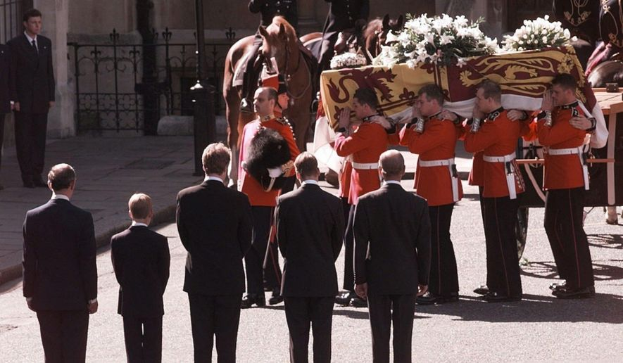 """FILE- In this Saturday, Sept. 6, 1997 file photo, Britain's Prince Charles, Prince Harry, Earl Charles Spencer, Prince William and Prince Philip, from left, stand as the coffin bearing the body of Princess Diana is taken into Westminster Abbey in London. It has been 20 years since the death of Princess Diana in a car crash in Paris and the outpouring of grief that followed the death of the """"people's princess."""" (AP Photo/John Gaps III, Pool, File)"""