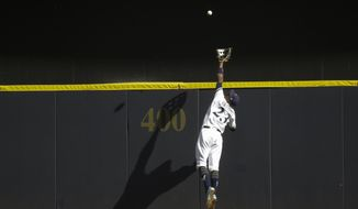 Milwaukee Brewers' Keon Broxton catches a ball at the wall hit by St. Louis Cardinals' Randal Grichuk during the ninth inning of a baseball game Wednesday, Aug. 30, 2017, in Milwaukee. The Brewers won 6-5. (AP Photo/Morry Gash)