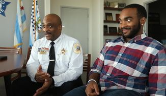 In this Monday, Aug. 28, 2017 photo, Chicago police Superintendent Eddie Johnson, left, and his son Daniel Johnson are interviewed in Superintendent Johnson's office at Chicago Police Department headquarters. Daniel Johnson is donating a kidney to his father. (Chris Walker/Chicago Tribune via AP)