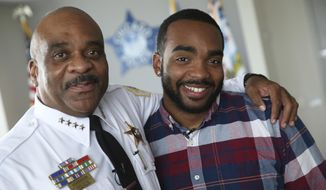 In this Monday, Aug. 28, 2017 photo, Chicago police Superintendent Eddie Johnson, left, and his son Daniel Johnson pose for a photo in Superintendent Johnson's office at Chicago Police Department headquarters. Daniel Johnson is donating a kidney to his father. (Chris Walker/Chicago Tribune via AP)