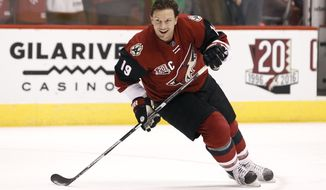 FILE - In this Dec. 27, 2016, file photo, Arizona Coyotes' Shane Doan skates during pre-game warm up before an NHL hockey game against the Dallas Stars, in Glendale, Ariz. Doan is retiring after 21 seasons with the same franchise. Doan announced his retirement in a letter to Coyotes fans published in The Arizona Republic. The 40-year-old Doan is the franchise's all-time leader in nearly every category, finishing his career with 402 goals and 570 assists in 1,540 games. (AP Photo/Ralph Freso, File)