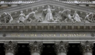 FILE - This Oct. 4, 2014, file photo, shows the facade of the New York Stock Exchange. U.S. stocks are quiet early Wednesday, Aug. 30, 2017, as technology companies rise while energy companies continue to fall as investors sort through the ongoing damage caused by Harvey. (AP Photo/Richard Drew, File)