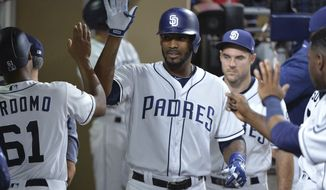 San Diego Padres' Jabari Blash is congratulated in the dugout after hitting a home run against the San Francisco Giants during the fourth inning of a baseball game Tuesday, Aug. 29, 2017, in San Diego. (AP Photo/Orlando Ramirez)