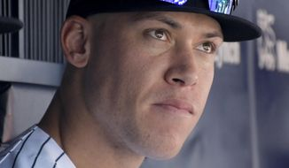 New York Yankees right fielder Aaron Judge watches from the bench during the fourth inning in the first game of a baseball doubleheader against the Cleveland Indians Wednesday, Aug. 30, 2017, at Yankee Stadium in New York. (AP Photo/Bill Kostroun)