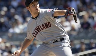 Cleveland Indians starting pitcher Trevor Bauer delivers the ball to the New York Yankees during the first inning in the first game of a baseball doubleheader Wednesday, Aug. 30, 2017, at Yankee Stadium in New York. (AP Photo/Bill Kostroun)