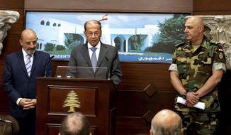 In this photo released by Lebanon's official government photographer Dalati Nohra, Lebanese Army Commander Gen. Joseph Aoun, right, and Spanish Defense Minister Yacoub Sarraf, left, listen to Lebanese President Michel Aoun, speaking to journalists at the Presidential Palace in Baabda, east of Beirut, Lebanon, Wednesday, Aug. 30, 2017. Aoun declared victory against the Islamic State group Wednesday in a live statement praising the Lebanese army for carrying out the operation that ended with the deal to evacuate IS fighters and their families in return for information about nine troops who were kidnapped by IS in August 2014. (Dalati Nohra via AP)