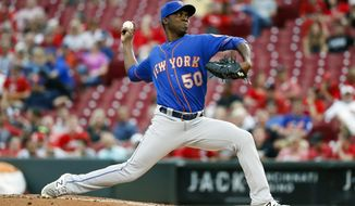 New York Mets starting pitcher Rafael Montero throws in the first inning of a baseball game against the Cincinnati Reds, Wednesday, Aug. 30, 2017, in Cincinnati. (AP Photo/John Minchillo)