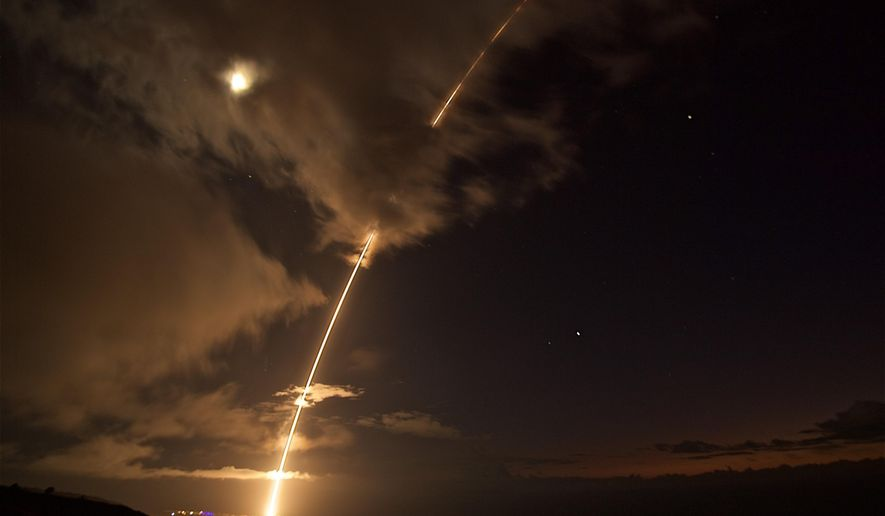 This Aug. 29, 2017 photo provided by the Department of Defense shows a medium-range ballistic missile target is launched from the Pacific Missile Range Facility on Kauai, Hawaii.  The U.S. military has shot down a medium range ballistic missile during a test off Hawaii. The Pacific Missile Range Facility on Kauai Island launched the target missile late Tuesday, Aug. 29. Sailors aboard the destroyer USS John Paul Jones tracked the target with radar and then fired an interceptor missile to shoot it down. The test comes amid ongoing North Korean ballistic missile tests. Earlier Tuesday (Latonja Martin/Department of Defense via AP)