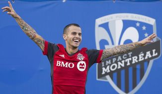Toronto FC's Sebastian Giovinco celebrates scoring against the Montreal Impact during second half MLS soccer action in Montreal, Sunday, Aug. 27, 2017. (Graham Hughes/The Canadian Press via AP)