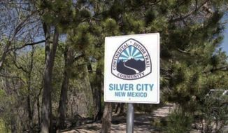 """In this 2015 photo a sign at the Silver City Visitors Center declares the town a Continental Divide Trail Community in Silver City, N.M. Silver City was the first """"Gateway Community"""" certified by the Continental Divide Trail Coalition. (Randal Seyler/The Deming Headlight via AP)"""