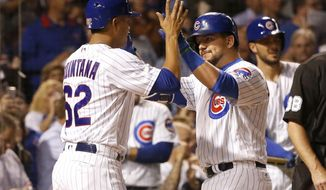 Chicago Cubs' Jose Quintana (62) and Kyle Schwarber celebrate after scoring on Schwarber's two-run home run during the fifth inning of a baseball game against the Pittsburgh Pirates on Wednesday, Aug. 30, 2017, in Chicago. (AP Photo/Charles Rex Arbogast)
