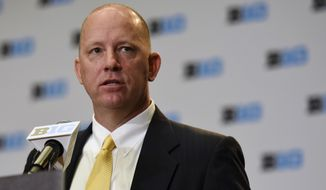 In this Tuesday, July 25, 2017 file photo, Purdue NCAA college football head coach Jeff Brohm speaks at Big Ten Media Day in Chicago. New Purdue coach Jeff Brohm is using some old lessons to map out his new adventure. His father helped him understand the intricacies of football while baseball taught how to cope with failures. (AP Photo/G-Jun Yam, File)