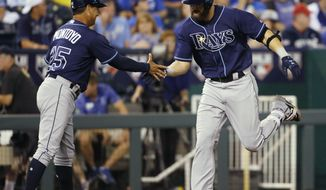 Tampa Bay Rays Steven Souza Jr. right, is congratulated by third base coach Charlie Montoyo after hitting a home run during the fifth inning of a baseball game against the Kansas City Royals at Kauffman Stadium in Kansas City, Mo., Wednesday, Aug. 30, 2017. (AP Photo/Colin E. Braley)