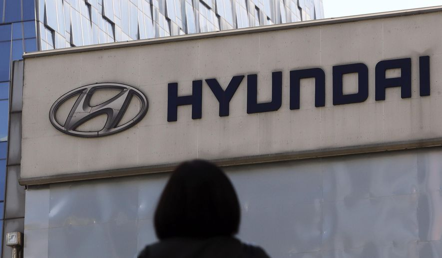 FILE - In this April 26, 2017 file photo, the logo of Hyundai Motor Co. is displayed at the automaker's showroom in Seoul, South Korea. Hyundai Motor Co. said Wednesday, Aug.30, 2017,  that it resumed production at its plants in China where the automaker has been working to resolve a dispute with a parts supplier that led to a complete production halt. (AP Photo/Lee Jin-man, File)