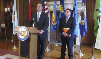 FILE - In this Nov. 15, 2016 file photo, Montana Gov. Steve Bullock, left, and the governor's budget director, Dan Villa, outline Bullock's proposed budget for the next two years in Helena. Montana government leaders plan to create rules for when and how to preserve text messages after a news organization's public-records request exposed the lack of a policy to retain the messages that have become a regular communication method for state business. Bullock's spokeswoman Ronja Abel said Monday, Aug. 28, 2017,  that Lee Newspapers of Montana's request for text messages between state lawmakers and budget director Dan Villa was the first of its kind received by the administration.  (AP Photo/Matt Volz, File)