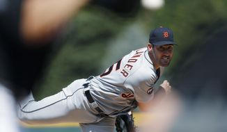 Detroit Tigers starting pitcher Justin Verlander,  reacts as he throws a pitch to strike out Colorado Rockies' Nolan Arenado in the first inning of a baseball game Wednesday, Aug. 30, 2017, in Denver. (AP Photo/David Zalubowski)