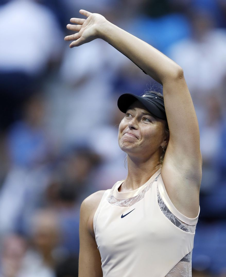 Maria Sharapova, of Russia, waves to fans after beating Timea Babos, of Hungary, during the second round of the U.S. Open tennis tournament, Wednesday, Aug. 30, 2017, in New York. (AP Photo/Adam Hunger)