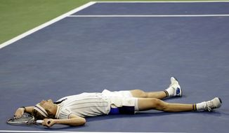 Alexander Zverev, of Germany, lies on the court after failing to return a shot to Borna Coric, of Croatia, during the second round of the U.S. Open tennis tournament, Wednesday, Aug. 30, 2017, in New York. (AP Photo/Julio Cortez)