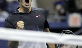 Roger Federer, of Switzerland, reacts after winning a game against Frances Tiafoe, of the United States, during the U.S. Open tennis tournament, Tuesday, Aug. 29, 2017, in New York. (AP Photo/Julio Cortez)