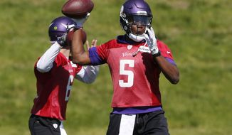 FILE - In this June 6, 2017, file photo, Minnesota Vikings quarterback Teddy Bridgewater throws a pass during the practice in Eden Prairie, Minn. One year ago, Teddy Bridgewater went down during a routine practice drill with a devastating injury to his left knee. Remarkable progress has been made in his recovery, but the Minnesota Vikings are still carefully bringing him back to action. (AP Photo/Jim Mone, File)
