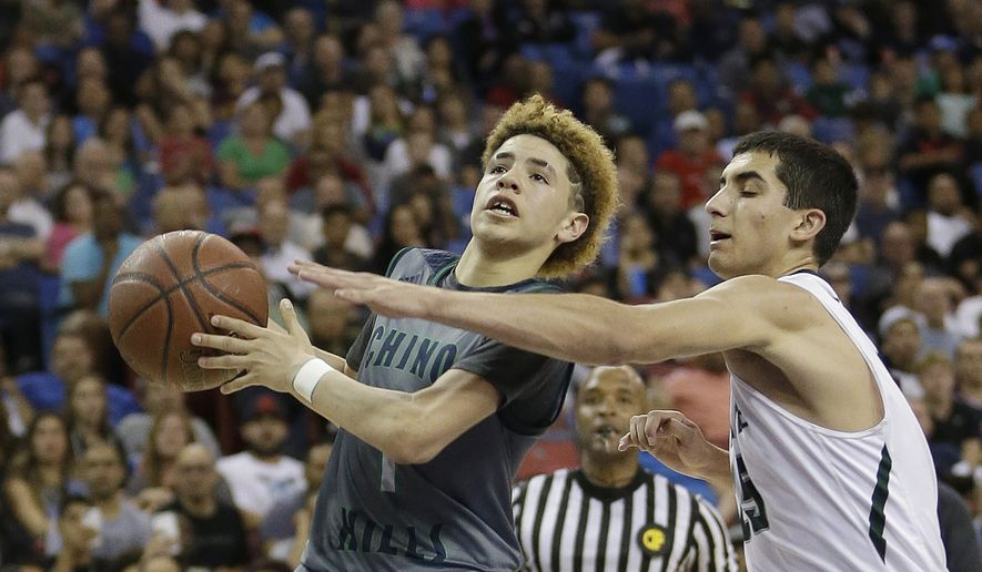 Chino Hills' Lamelo Ball, left, goes to the basket against De La Salle's Jordan Ratinho during the second half of the CIF boys' Open Division high school basketball championship game Saturday, March 26, 2016, in Sacramento, Calif. Chino Hills won 70-50. (AP Photo/Rich Pedroncelli) **FILE**