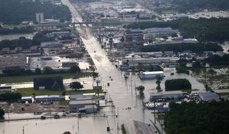 Floodwaters from Tropical Storm Harvey cover streets in Port Arthur, Texas, Thursday, Aug. 31, 2017. (AP Photo/Gerald Herbert)