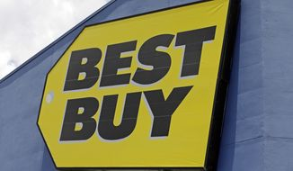 This Monday, May 22, 2017, photo shows a Best Buy sign at a store in Hialeah, Fla. Macys and Best Buy are expanding their same-day delivery as they aim to become more competitive with online leader Amazon. (AP Photo/Alan Diaz)