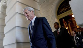In this June 21, 2017, file photo, former FBI Director Robert Mueller, the special counsel probing Russian interference in the 2016 election, departs Capitol Hill following a closed-door meeting in Washington. A grand jury used by Mueller has heard secret testimony from a Russian-American lobbyist who attended a June 2016 meeting with President Donald Trump's eldest son, The Associated Press has learned. (AP Photo/Andrew Harnik, File)